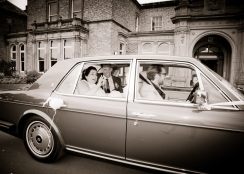 Bride & Groom leave in Chauffeur.
