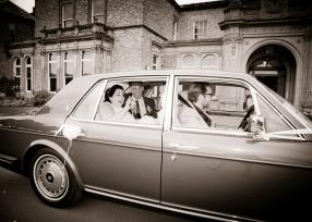 Bride & Groom leave in Chauffeur.