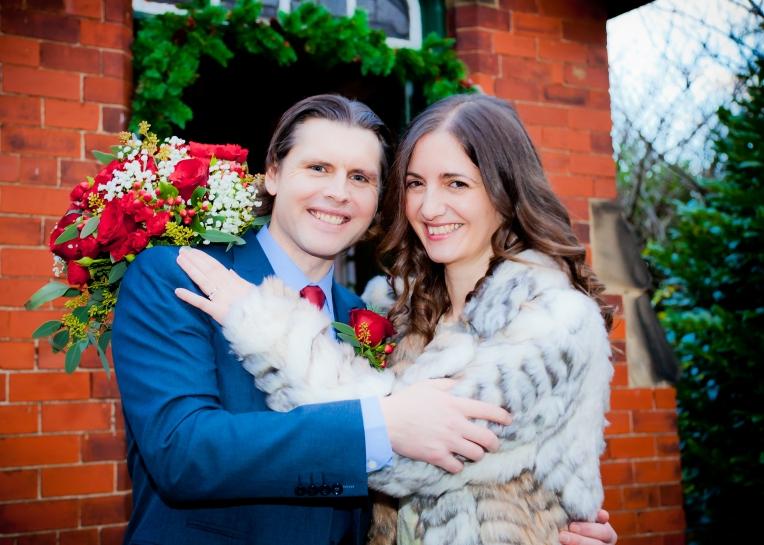 Wedding couple pose outside church