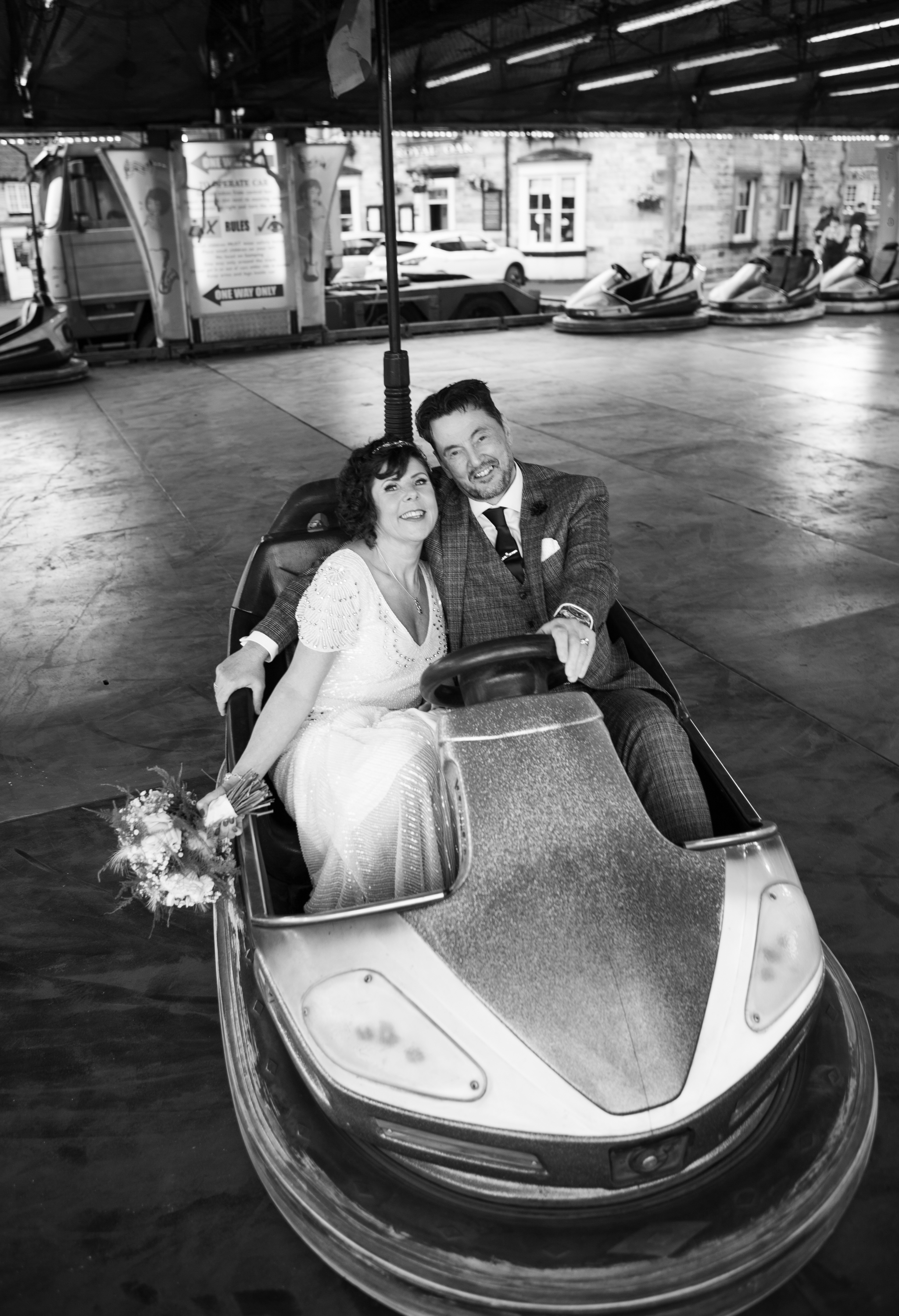 Wedding couple in dodgem car