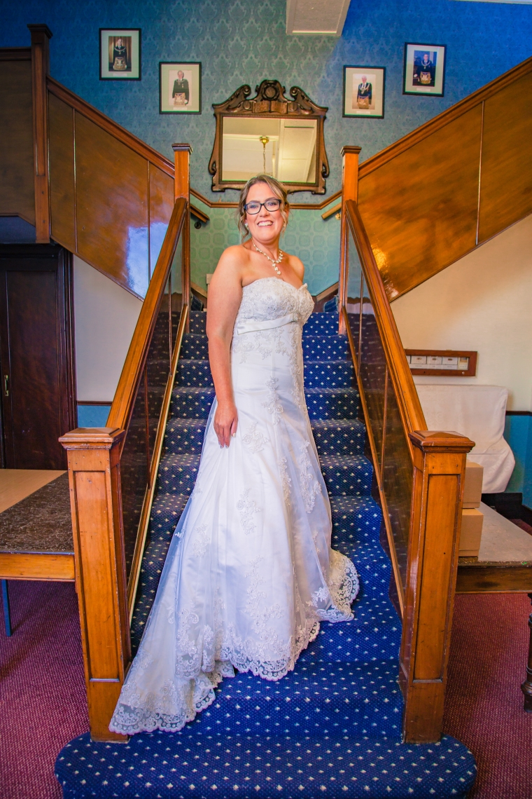 Bride poses for photographs at Stockton Masonic Hall